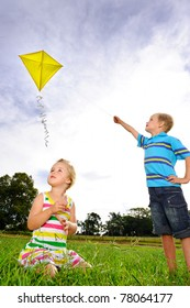 Young children having fun with their kite