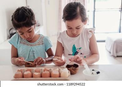 young children planting seedlings in reuse eggshells, montessori homeschool education