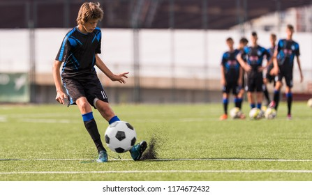 Young children player on the football match field
