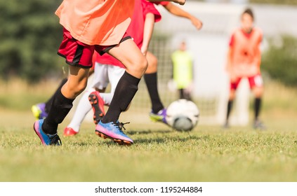 Young children players on the football match field
