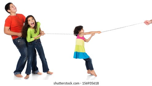 Young children playing tug of war. Image is isolated on a white background.