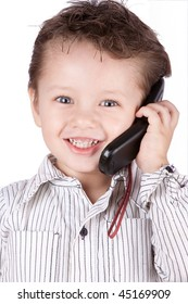 YOUNG CHILDREN POSING AS BUSINESSMAN SPEAKING ON HIS MOBILE PHONE