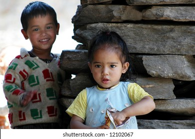 Young children posing with smiles in Northern India, representing positive aspects of society in developing countries