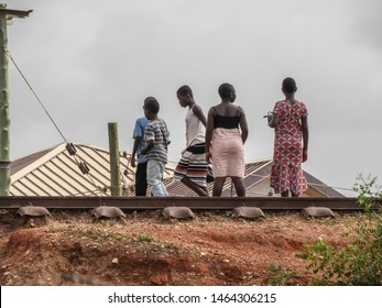 Young children use the railroad as a pedestrian street to and from school in an area called Teshie Accra. Photo taken in Ghana Accra Teshie 2018 April 13 in the morning.