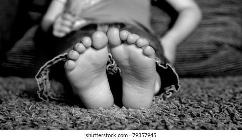 Young Child's bare feet on floor of home