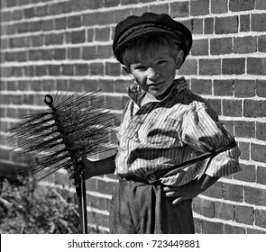 Young Chimney Sweep with Brick Wall in Black and White