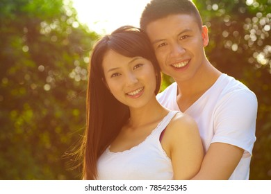 Young Chinese Boyfriend and girlfriend outdoor in the park together