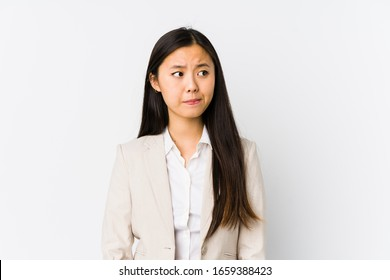 Young chinese business woman isolated confused, feels doubtful and unsure.