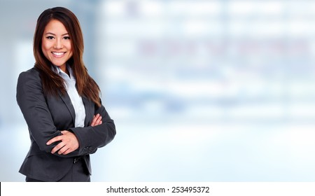 Young chinese Business woman over office background