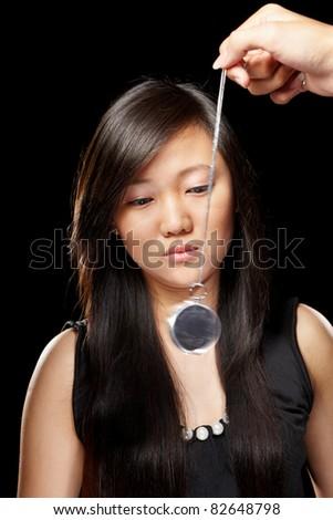 Asian girl hypnotized