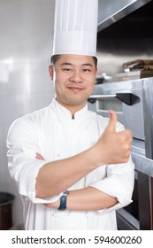 young chinese man chef in modern kitchen