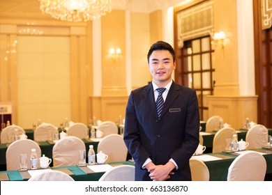 young chinese man service in meeting room