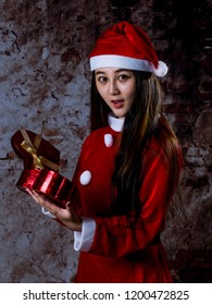 Young Chinese woman, dressed as Santa Claus