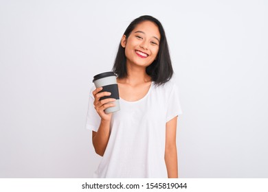 Young chinese woman drinking take away glass of coffee over isolated white background with a happy face standing and smiling with a confident smile showing teeth