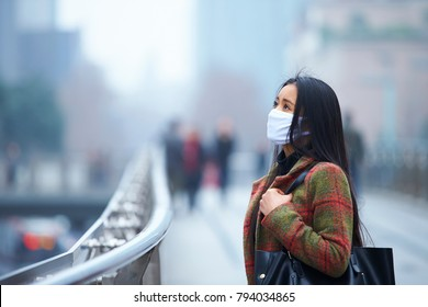 young Chinese woman wear mask in the city during Smog day