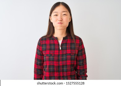 Young chinese woman wearing casual jacket standing over isolated white background puffing cheeks with funny face. Mouth inflated with air, crazy expression.