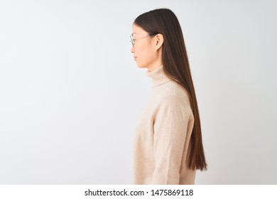 Young chinese woman wearing turtleneck sweater and glasses over isolated white background looking to side, relax profile pose with natural face with confident smile.