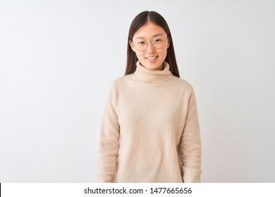 Young chinese woman wearing turtleneck sweater and glasses over isolated white background with a happy and cool smile on face. Lucky person.