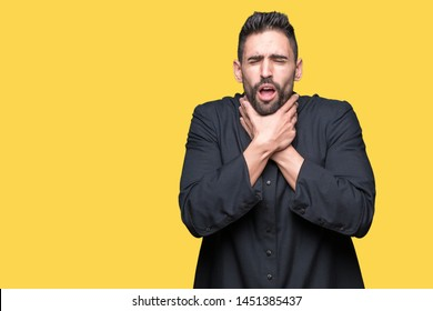 Young Christian priest over isolated background shouting and suffocate because painful strangle. Health problem. Asphyxiate and suicide concept.