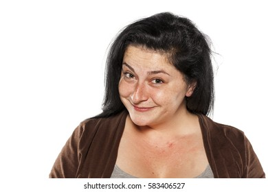 Young chubby and freckled woman without makeup
