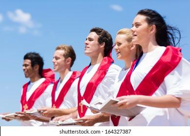 young church choir singing outdoors