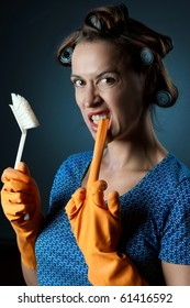 A young cleaning woman with a rubber glove in a cleaning scenario, not happy