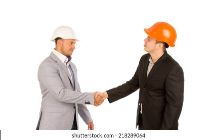 Young Client in Black Suit and Orange Helmet Shaking Hand with Engineer in White Helmet. Isolated on White Background.