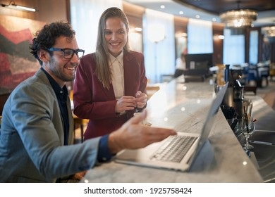Young colleagues talking about business deal at a coffee break in a relaxed atmosphere at the bar. Business, people, bar