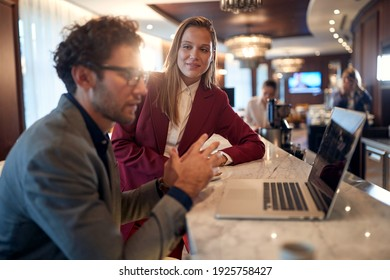 Young colleagues talking about business plans in a working atmosphere at a coffee break at the bar. Business, people, bar