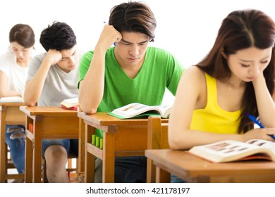 young college student group study in a classroom
