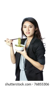 young and confident asian businesswoman eating noodles