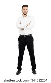 Young confident business man with crossed arms looking at camera. Full body length portrait isolated over white studio background.
