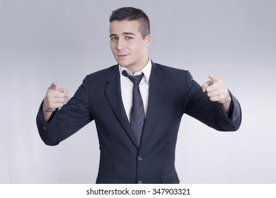Young confident businessman pointing