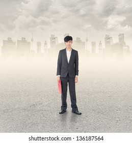 Young confident businessman stand at a modern city.