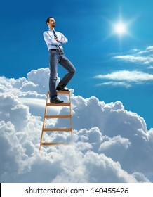 Young confident businessman standing at the top of ladder high in the sky and looking for new opportunities