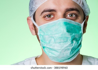 Young confident and friendly doctor isolated