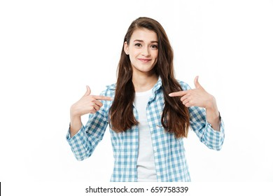 Young confident girl pointing with fingers at herself isolated over white
