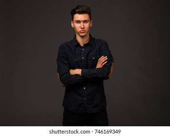 Young confident man portrait of a businessman on a black background. Ideal for banners, registration forms, presentation, landings, presenting concept.
