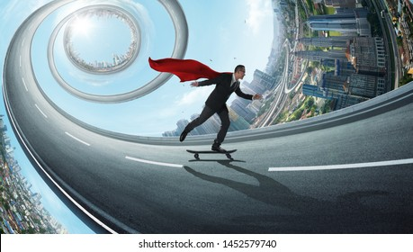 Young confident super businessman in red cape and black suit taking a ride on a skateboard in the abstract rotate road with distortion city .