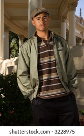 young confident teen standing outside