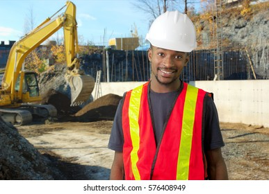young construction worker foreman working on site, white helmet