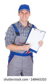 Young construction worker writing on clipboard isolated on white background