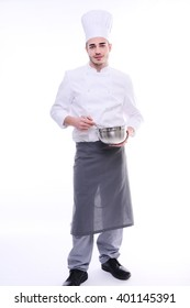 young cook chef isolated on white background with a bowl and whip preparing food