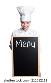 young cook holding a menu chalkboard