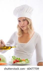 young cook seasoned salad