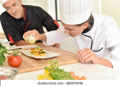 Young cook student in training course