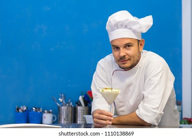 young cook watching his culinary creation
