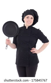 young cook woman in black uniform with frying pan isolated on white background