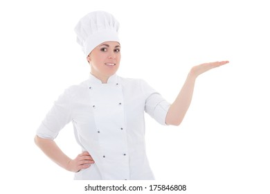 young cook woman showing or presenting something isolated on white background
