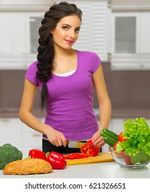 Young cooking woman at kitchen